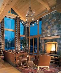 timber frame home cathedral ceiling great room stone fireplace wooden mantel best lighting for cathedral ceilings