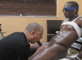 White man eats black sperm