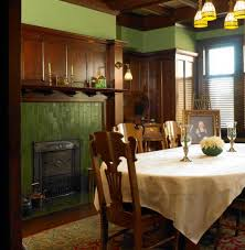 the dining room has a typically masculine look with a high wood wainscot and butchart
