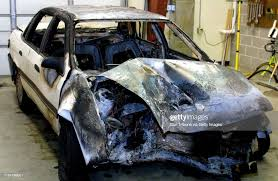 The burned out vehicle from which mailman Bob Trester of Andover ...