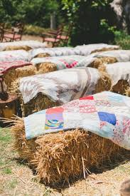Hay bale seating and vintage blanket decor inspiration for a relaxed wedding  // The Natural