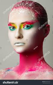white skin beautiful make up of bright lips drawing on the body unusual
