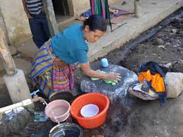 woman washing clothes by hand. Interesting Hand Some Women Use A Large Rock To Wash Clothes  Intended Woman Washing Clothes By Hand W