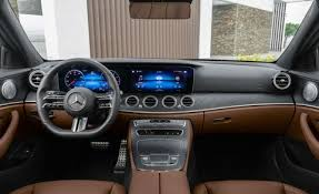 A neat row of toggle switches for the climate control on the dash, as well as a few other vital buttons are the only real items to press and prod, as the rest of the infotainment system is controlled from the rotary wheel on the transmission. 2021 Mercedes Benz E Class Review Pricing And Specs