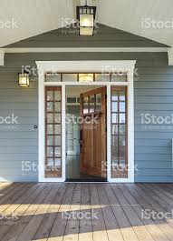 open front door. Front Porch Of Blue-gray House With Open Door Royalty-free Stock Photo H