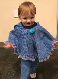 granddaughter in poncho and pants it twirls in cat