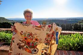 Road to California Quilting Convention to celebrate 20 years this ... & Fairy Earnest, 89, holds up one of her award-winning quilts. ( Adamdwight.com