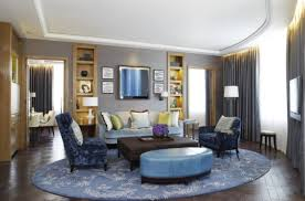 modern round area rugs for living room with accent wall