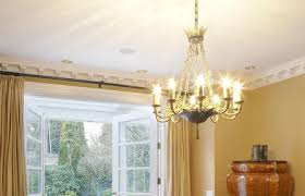 dinning room with chandelier and french doors open to garden