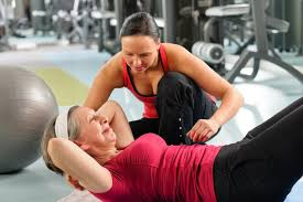 personal trainer liability insurance senior woman exercise abdominal in fitness center