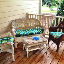 spray painting old white wicker