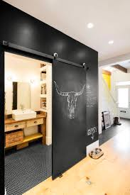 Chalkboard sliding door in a renovated Montreal row house