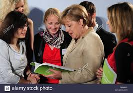 Chancellor Angela Merkel speaks to young participants of the project Stock  Photo - Alamy
