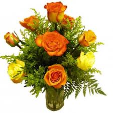 florist in tulsa flower delivery twelve mixed color roses arranged in a gl vase with