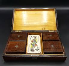 wooden card box with slot a in which boxes bone chips and antique wooden card box