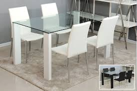 modern glass dining table. dining room. fascinatnig design of table with glass material plus white chair leather modern e
