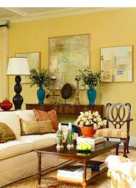 furniture living room wall: living room traditional home magazine we have the yellow walls i like the vases and the furniture the art pillows and rug not so much