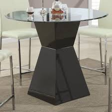 furniture round glass dining table with square black wooden base on grey rug minimalist