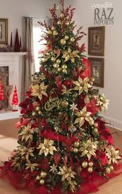 A beautiful way to decorate your Christmas tree. deco mesh, artificial gold  poinsettias, flower sprays, and ornaments. Red and gold always goes  elegantly ...