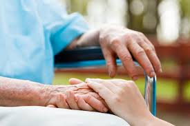 an elderly person s hand held by a younger hand