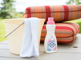 woolite is a good mild detergent to try cleaning outdoor fabrics with