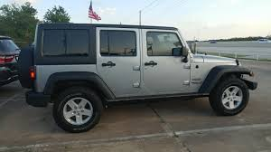 2018 4 door silver jeep wrangler unlimited sport