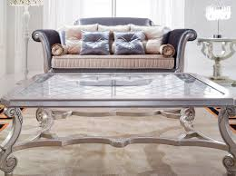 coffee table simple artistic silver and glass coffee table curving legs huge large tremendous indoor