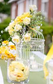 Wedding Design Ideas large birdcage and yellow flower centerpiece idea summer yellow wedding design ideas