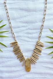 view of the trip to bora bora necklace that features a large gold chain with long