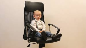 cute childs office chair. little kid jumping from the office chair cute childs