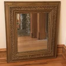 antique mirror with ornately carved wooden frame