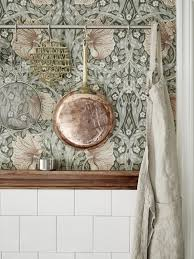 loving the william morris wallpaper with the copper and brass this could make a really charming wallpaper office 2 modern