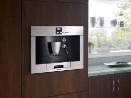 Installed in a cabinet wall, built-in coffee makers grind, brew and serve