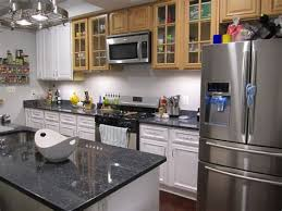 black kitchen cabinets grey wall white cabinets green countertop