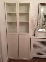 white ikea billy bookcase with half glazed doors