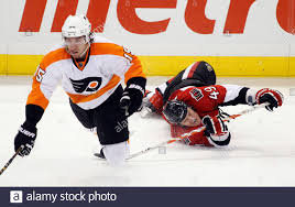 Ottawa Senators' Francis Lessard (R) trips Philadelphia Flyers' Andreas Nodl  during the second period of their NHL hockey game in Ottawa April 5, 2011.  REUTERS/Blair Gable (CANADA - Tags: SPORT ICE HOCKEY