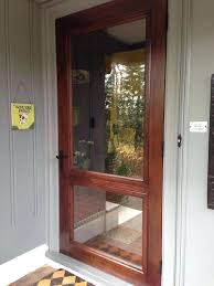p wooden storm door with glass wood screen and