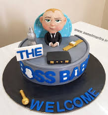 Boss Baby Theme Cake With Boss Baby Boy Dressed In Suit For