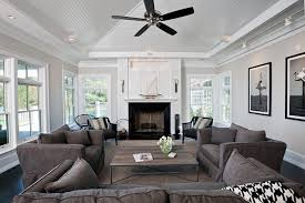 luxurious beachstyle livingroom sisal rug collection of sailboat on mantel with mantel decor with dark gray armchair livingroom white ceiling collection of