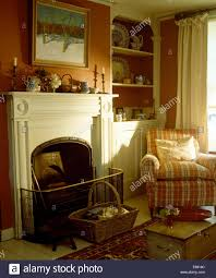Living Room Alcove Checked Armchair In Front Of Alcove Shelves In Terracotta Painted