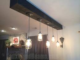 wooden ceiling lighting ideas room with beams faux wood work wooden ceiling lighting