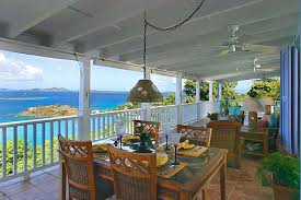 the sea air will draw you across the 49 foot classic caribbean porch with comfortable teak and upholstered furniture arranged for relaxation and dining caribbean furniture