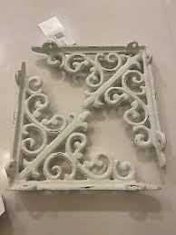 new pair of antique white ornate cast
