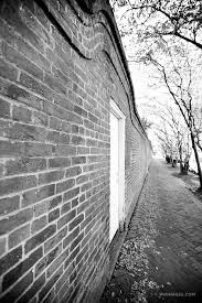 old brick wall garden district new orleans louisiana black and white