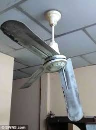the ceiling fan which was severely dented by the impact