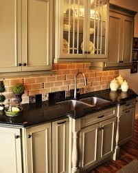 off white cabinets dark floors. dark floors and counters with cream cabinets--i would want the to be off white cabinets