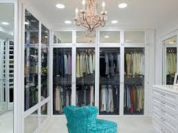 dreamy walk in closet with turquoise chair