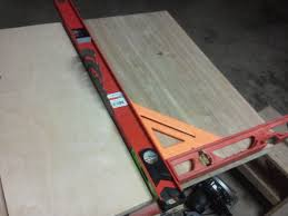 diy table saw fence. first thing you have to do is make sure the edges on new table are perpendicular blade. i did this by putting a level against blade (be diy saw fence o