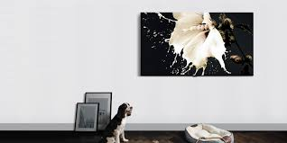 Samsung QLED TV mounted on a wall, with a dog, dog bed, and