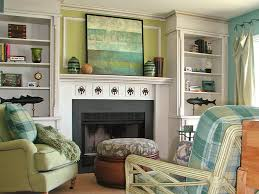 decorating a fireplace mantel with a tv above it style